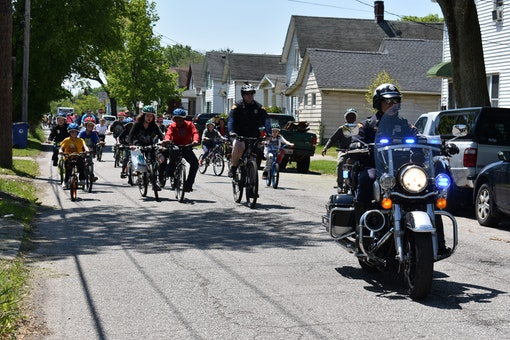 Police escort youth on community bike ride