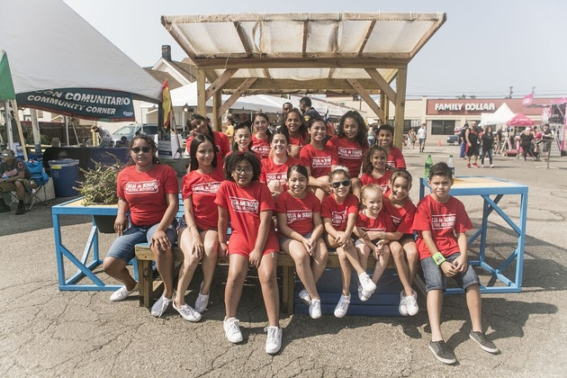group of youth in red shirts